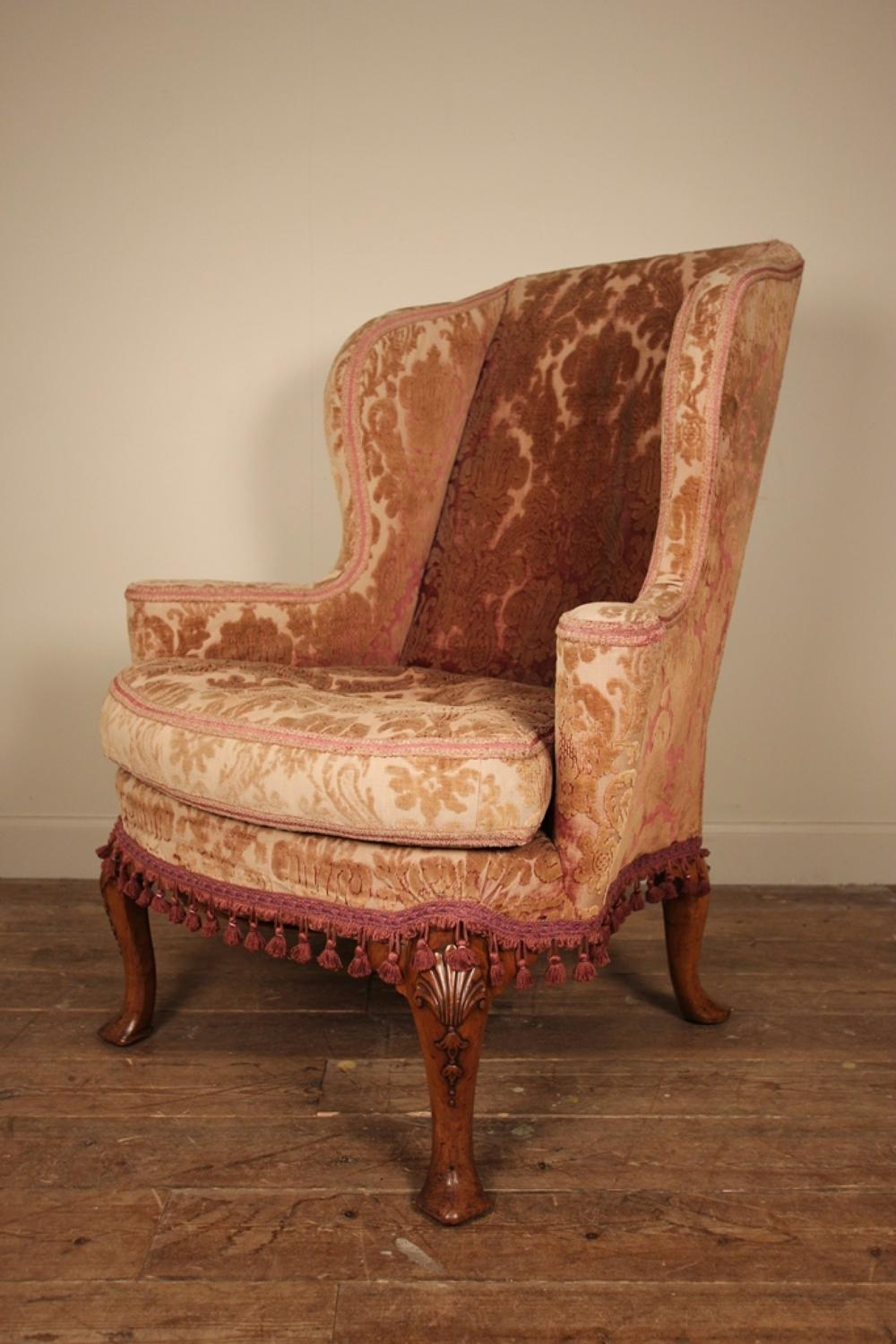 Shapely early 20th C. Queen Anne Walnut Wing Chair