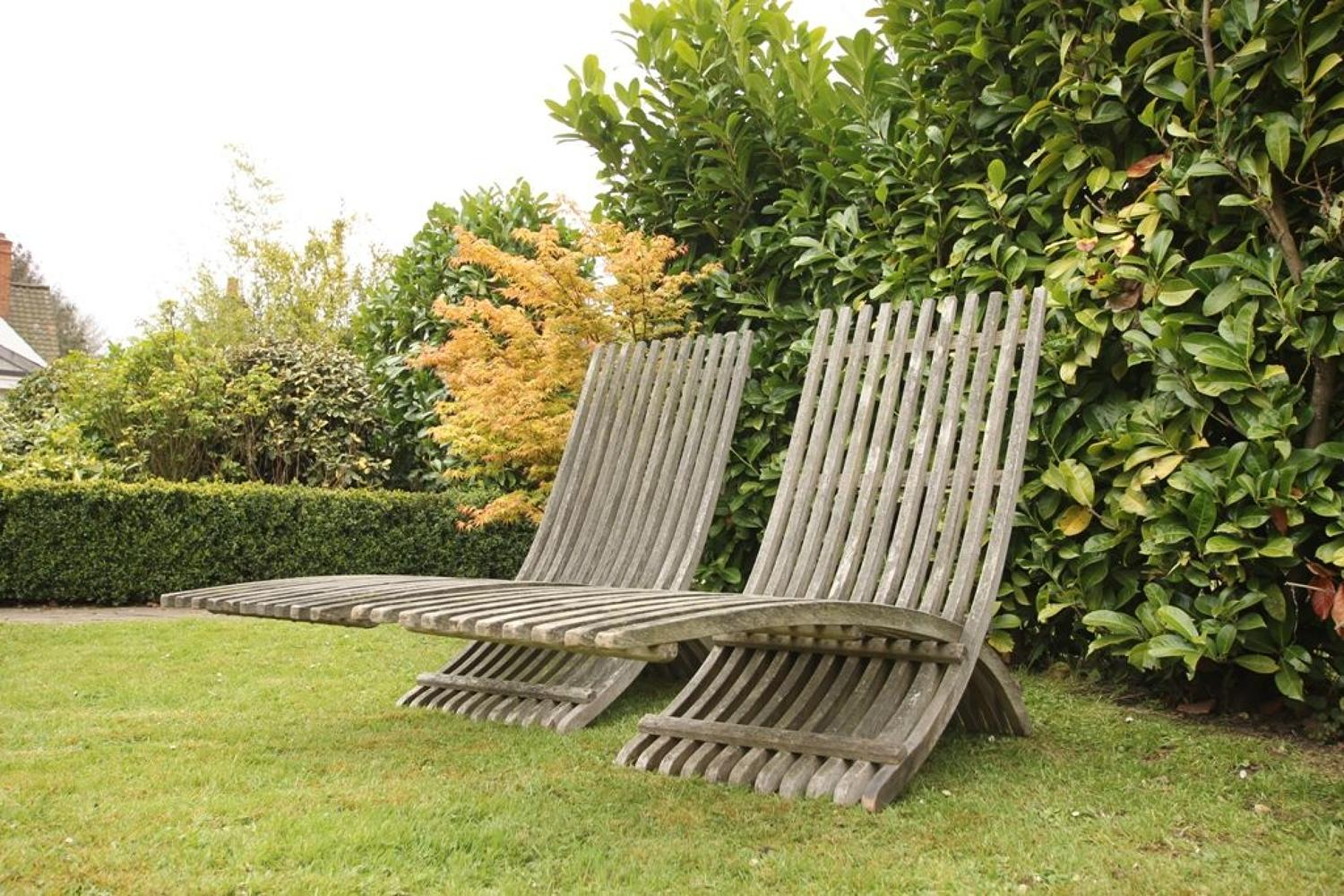 Stylish Pair of 1920's Teak Garden Lounger Chairs